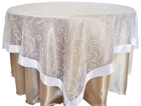 white embroidered swirl sheer organza table overlays