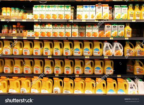 Shelf Of Orange Juice by Toronto Canada May 26 2014 Orange Juice Bottles On