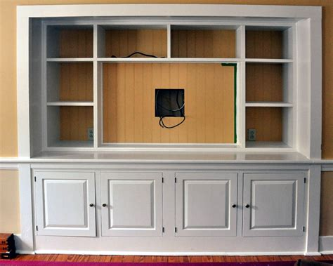built in tv cabinet turning a bedroom closet into a entertainment center with