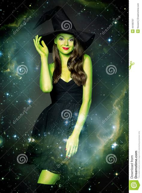 beautiful young woman  halloween witch stock image