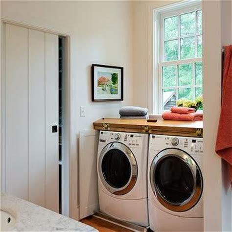 concealed stacked washer and dryer transitional bathroom washer and dryer transitional laundry room