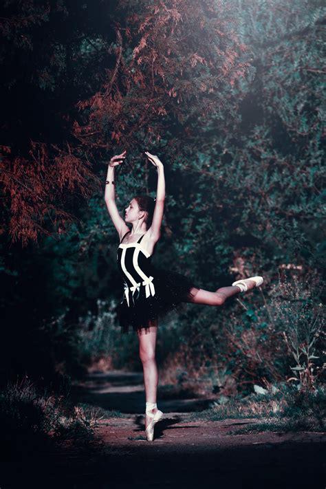 woman  blue ballerina dress performing dance