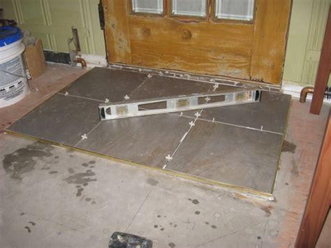 100 doors 18 floor installing a tile landing plus raising a door sill