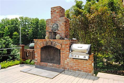 gorgeous outdoor fireplace and built in grill lake