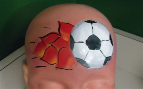 soccer ball with flames boy s face painting by let s flaming soccer ball face paint face paint sports pinterest