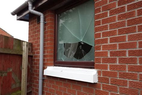 smashed house window sandy row house smashed up by masked gang as victim with a heart condition hides