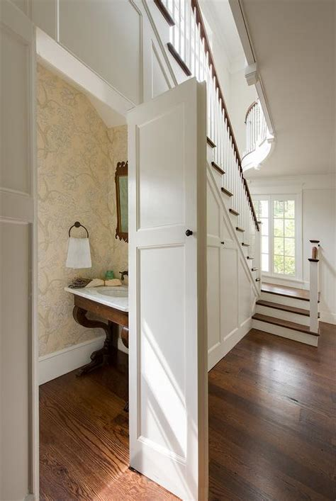 under stairs concealed powder room under the stairs transitional