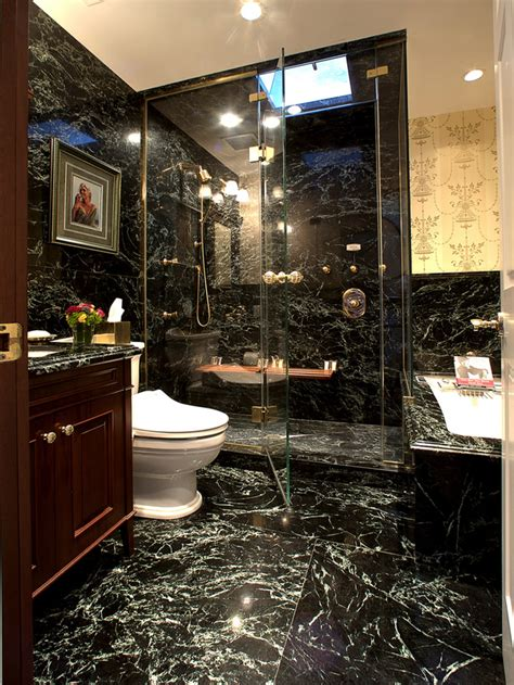 marble bathroom with glass enclosed shower and