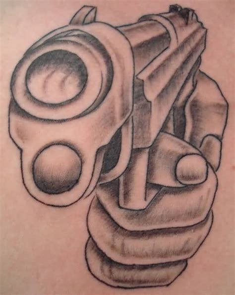 tattoo gun designs gun tattoo 9mm hand gun tattoo design tattooshunter com