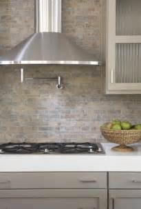 tiling backsplash taupe cabinets contemporary kitchen terracotta