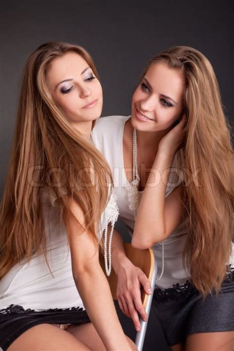 old gratis escuchar youngest girl to have twins 8 yrs old mp3 online two beautiful girls twins on the black background stock