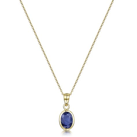9ct yellow gold blue sapphire rubover set oval pendant