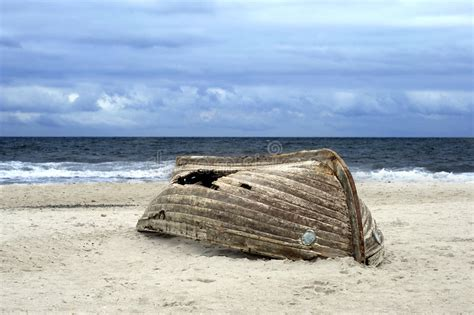 old boat on beach overturned boat on beach stock photo image of beach