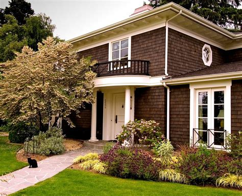 shingle sided houses dark brown house exterior traditional with white pillars white front door shingle exterior