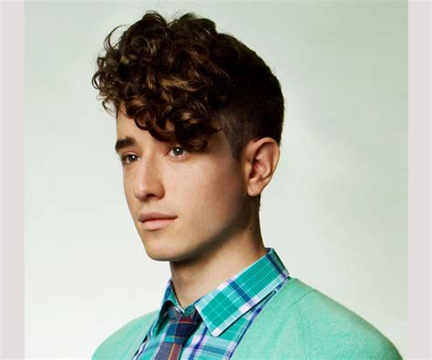 mens uneven layered verses even layered uneven hairstyles for men one curly side banged achieved