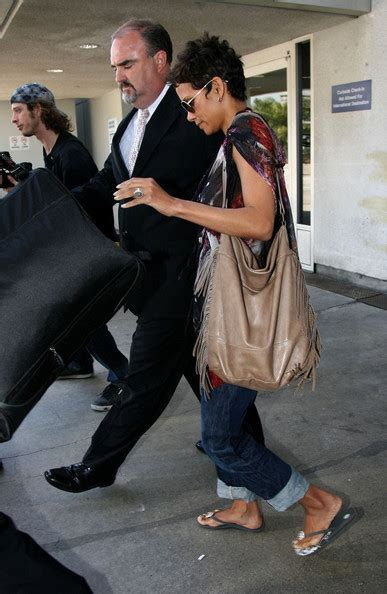 Name Halle Berrys Black Handbag by Halle Berry Tasseled Tote Halle Berry Looks Stylebistro