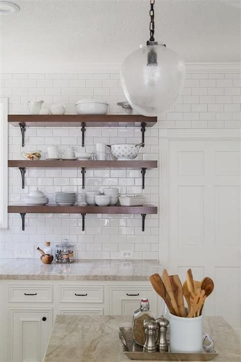 stacked wood kitchen shelves with iron brackets fantastic kitchen features white cabinets paired with taj