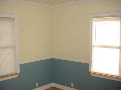 two tone painted walls with chair rail paint colors colors and chairs on