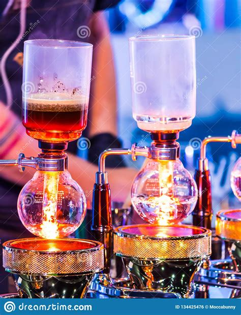 showcase syphon coffee maker  syphonist stock photo image  filter boiling