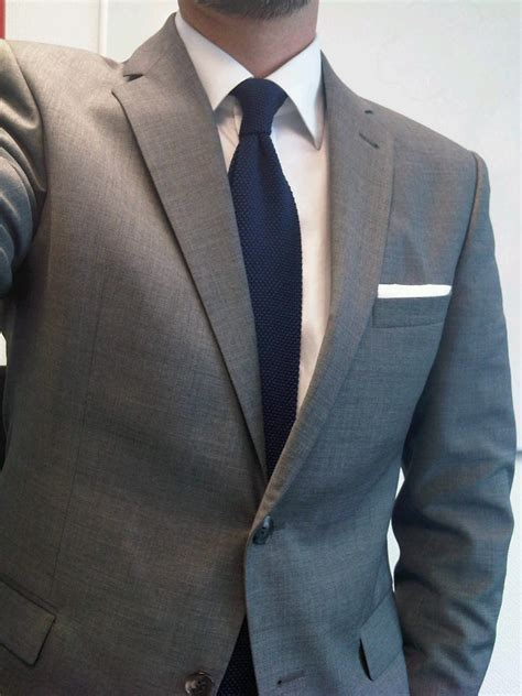 knit tie with suit inner city style grey suit and navy knit tie
