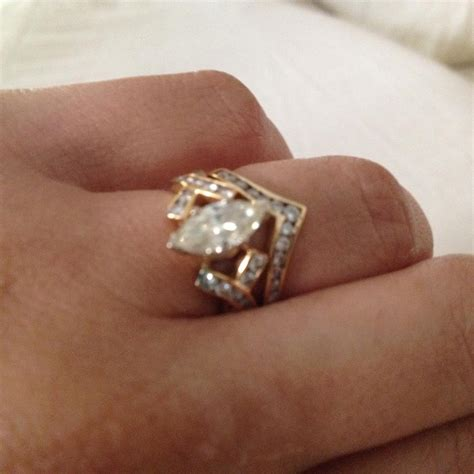 gold marquise engagement ring and chevron s