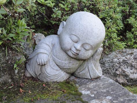 baby buddha asleep in japanese garden japanese gardens
