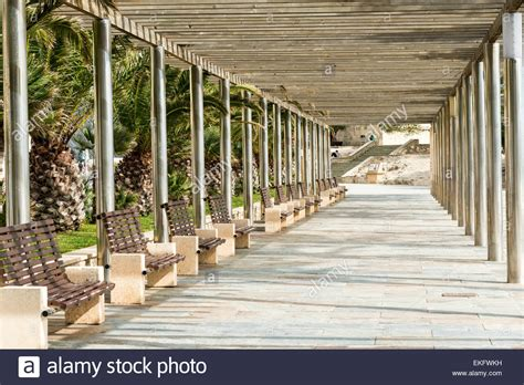 covered benches a modern covered walkway with benches and seats on the