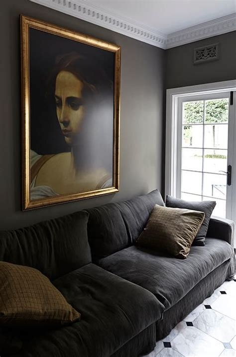 charcoal gray vvlvet sofa contemporary living room elle decor warm gray painted living room with white crown moulding