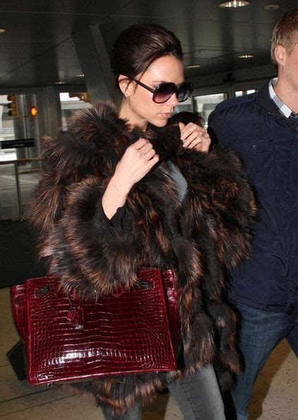 Mrs Beckham Looks Cool In by Beckham Twist Hair Updo And