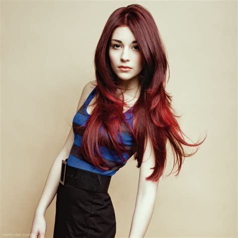hairstyle with dark color underneath and layered extra long and layered hairstyle with a dark red haircolor