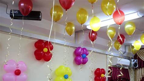 Balloon Falling From Ceiling by Yellow Blue Green And Balloons Ceiling In