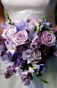 wedding flowers purple wedding bouquet purple sweet pea freesia and lilac www tablescapesbydesign https