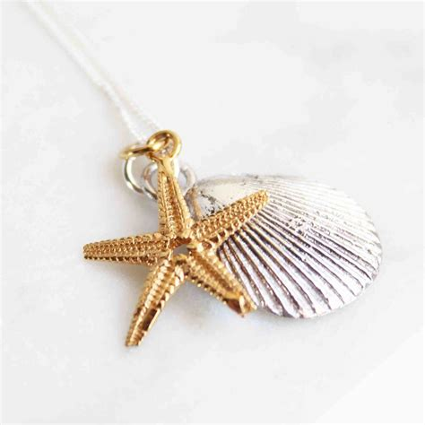 silver shell and gold starfish necklace by lime tree