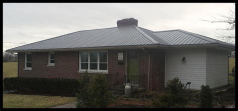 1 40 year charcoal metal roofing on a hip roof house