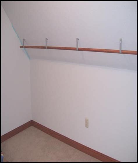 Hanging Clothes Rod From Ceiling by 17 Best Ideas About Closet Rod On Closet