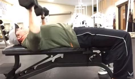 chest press on bench how to do the dumbbell chest press on a bench or ball