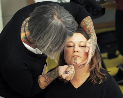 women s traditional chin tattoos are making a comeback in