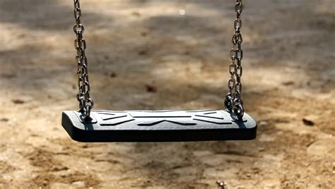 empty swing empty abandoned swing seat dangling stock footage video