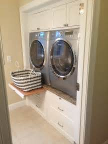 Undercounter washer and dryer cabi further pull out laundry room cabi