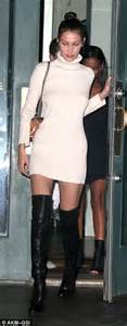 bella hadid shines in clingy white sweater dress and thigh