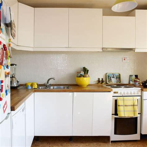 Home Design Magazines Nz white kitchen with wooden worktops 1970s inspired flat