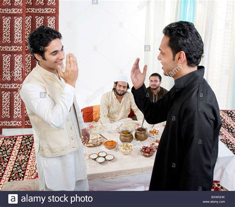 muslim men greeting each other stock photo royalty free