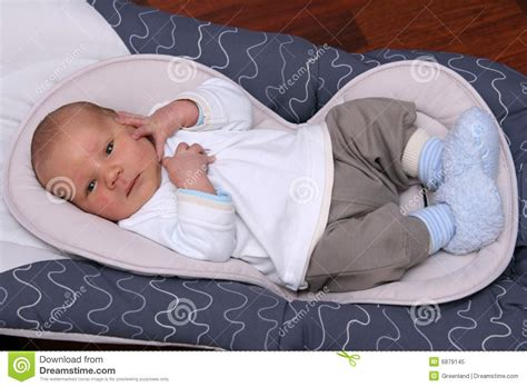 newborn only sleeps in bouncer chair newborn baby lying in bouncer chair stock image image