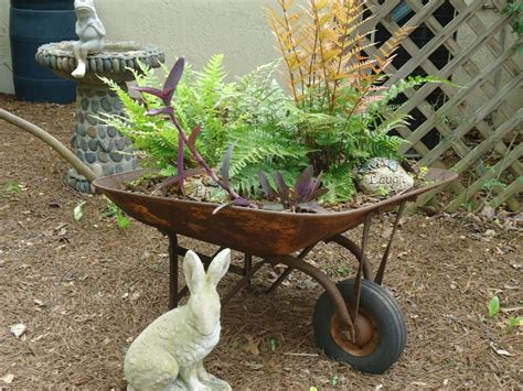 Small Wheelbarrow Planter by Wheelbarrow Planter Must Do This With S Defunct