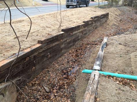 railroad tie retaining wall installation in tulsa railroad