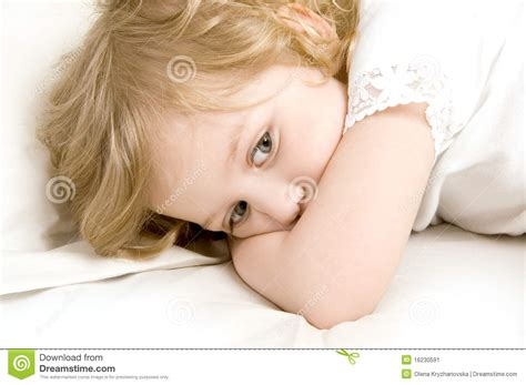 girls in bed sad little girl in the bed close up stock image image