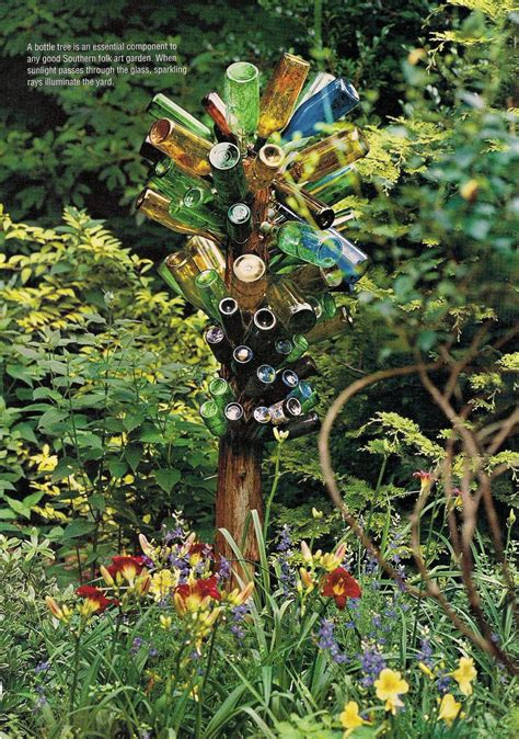 bottle trees and the whimsical of garden glass bottle trees in the garden landscape