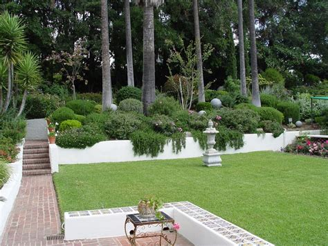landscape designs for backyard slopes hillside landscaping how to landscape a slope landscaping network