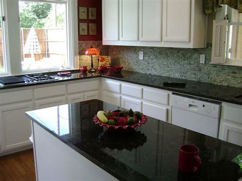 green peacock granite with white cabinets put my verde butterfly sle to the test kitchens