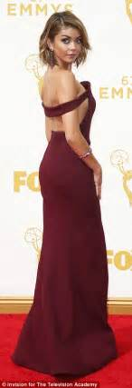Sarah Hyland attends the Emmy Awards 2015 wearing a wine coloured gown   Daily Mail Online